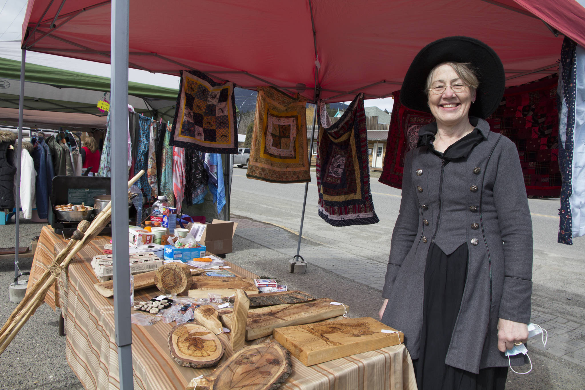 Bernice Weihs-Anderson creates art with reclaimed wood and flogs it at the Clinton Outdoor Market. (Kelly Sinoski photo - 100 Mile Free Press).