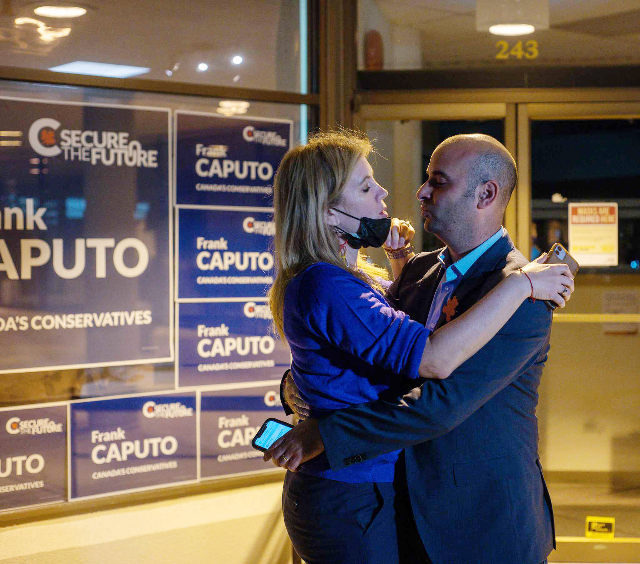Frank Caputo shares a celebratory hug with his wife Odette Dempsey-Caputo at his Seymour Street campaign office on election night. (Dave Eagles photo - KTW).